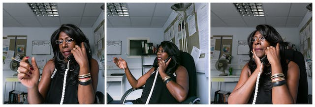 Photographic triptych showing the same woman in each image, sat in an office environment. In the left hand image the woman holds a landline telephone receiver to her left ear, her right hand is raised holding a pen. In the middle image she holds the receiver to her left ear and she is looking away to camera left, mid sentence. Her right hand is raised and still holds the pen.In the right hand image she holds the receiver to her left ear, her light hand is supporting her chin and she is looking off to camera left.