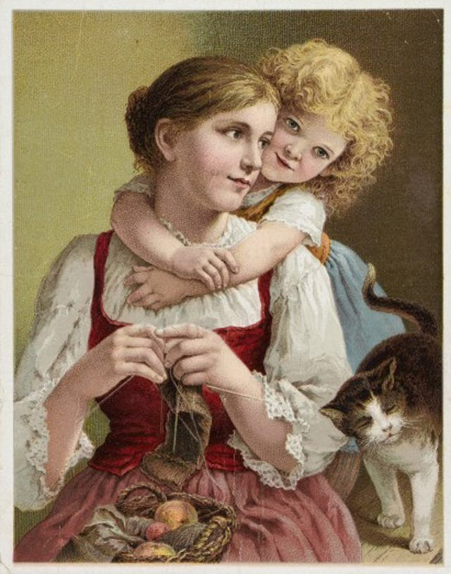 Mother knitting and young daughter with cat