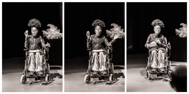 Photographic triptych, black and white with a warm tone. Each image shows the same young woman seated in a wheelchair against a black curtain and lit by a spotlight. She is performing to an audience. Her facial expression and gesticulation changes in each image.