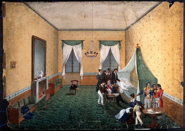 Watercolour showing the interior of a grand bedroom, with a dying man in bed being attended by several men and women.
