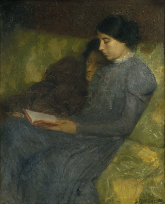 Oil painting depicting two women in long-sleeved long-skirted dark dresses sitting on a floral seat and leaning against each other and reading a book.