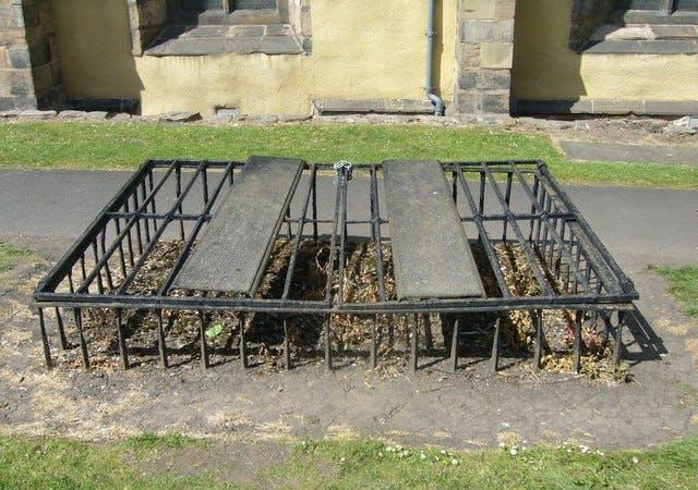 Mortsafe in Greyfriars churchyard, Edinburgh, used to deter body-snatching by