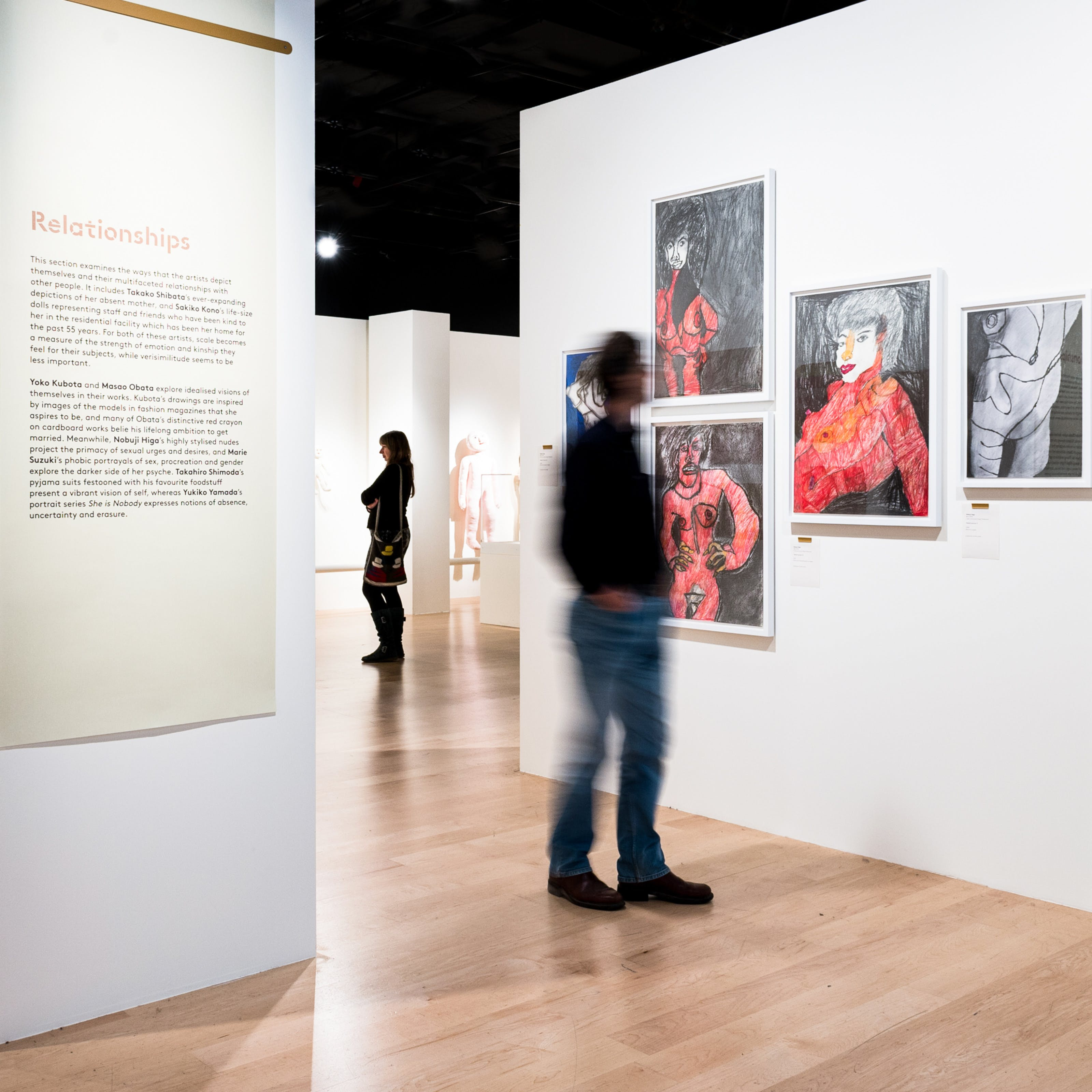Photograph of visitors exploring the exhibition, Souzou: Outsider Art from Japan, at Wellcome Collection.