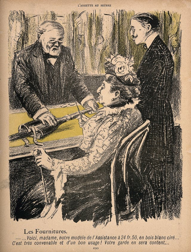 A sketched cartoon in which a woman sits in front of a man who is holding a prosthetic leg whilst she holds up pince nez to look more closely.