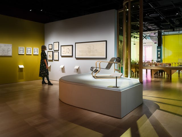 Photograph of curator Emily Sargent looking at the exhibition Living with Buildings at Wellcome Collection.
