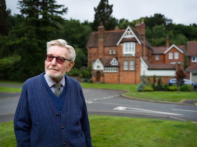 Photographic portrait of Peter Tonks outside the former Rubery Hill Hospital, Birmingham.