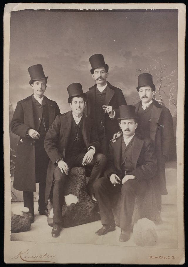Five well-dressed men in beaver felt top hats, 1886.