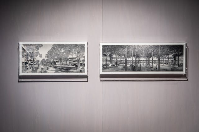 Photograph of framed works on hanging on the wall of the exhibition, Living with Buildings at Wellcome Collection.