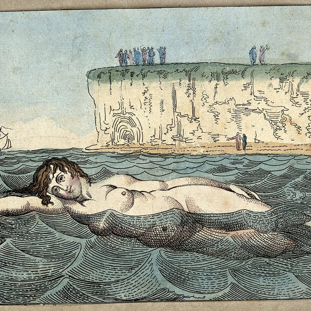 Coloured line engraving of a woman swimming in the waves of the sea whilst behind people stand on the beach and cliffs.