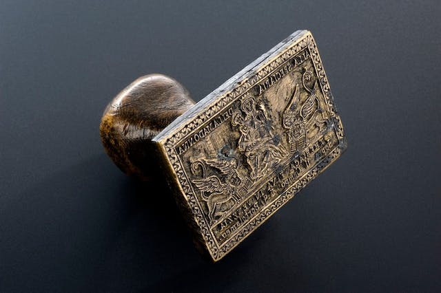 Image of small wooden stamp with medieval image.