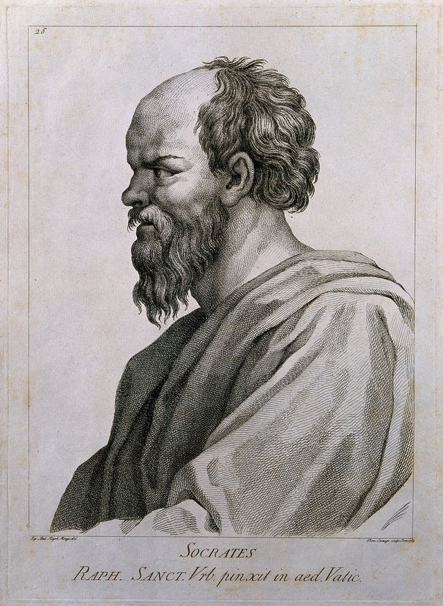 Black and white line engraving of a bearded, balding man in profile.
