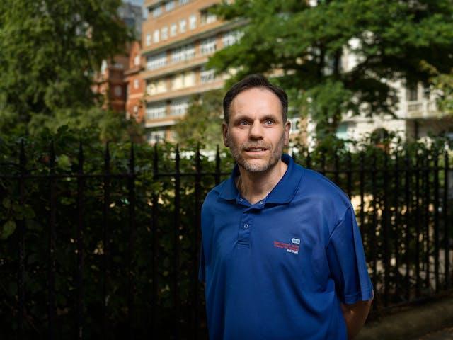 Photographic portrait of Adrian Godbold, a hospital porter, outside Great Ormond Street Hospital, London.
