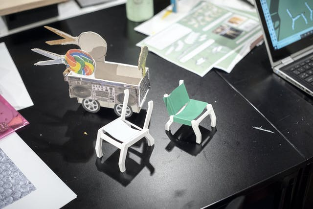 Three miniature prototypes of chairs and musical trolleys