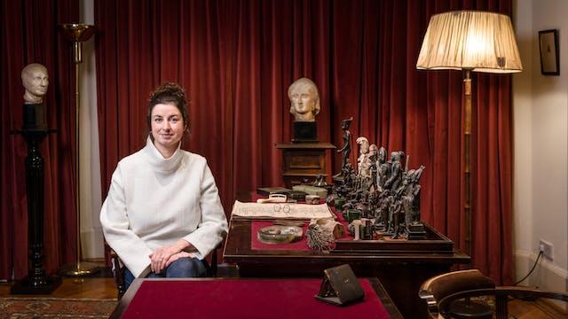 Photographic portrait of artist Emma Smith sitting at Freud