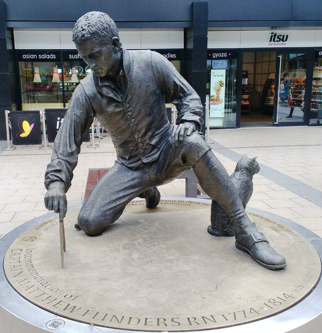 Colour photograph of the statue of Matthew Flinders outside Euston Station