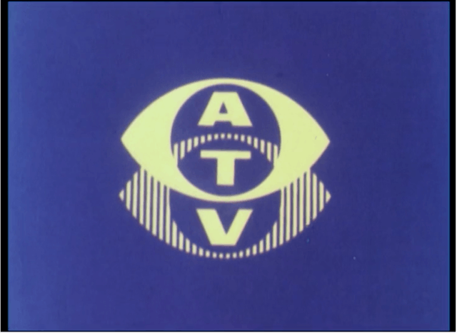 Film still of a yellow logo on a blue background with the acronym