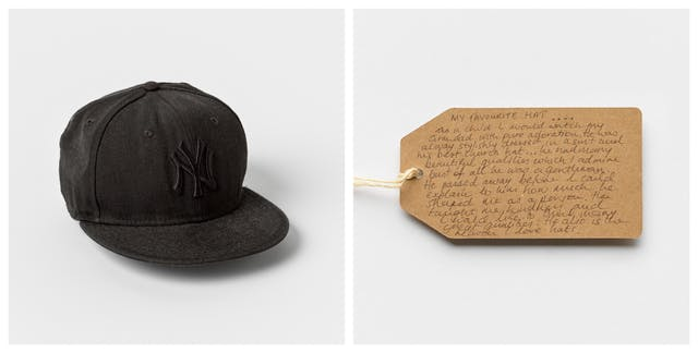 Photographic diptych showing a handwritten brown card label on the right and a black baseball cap on the left.