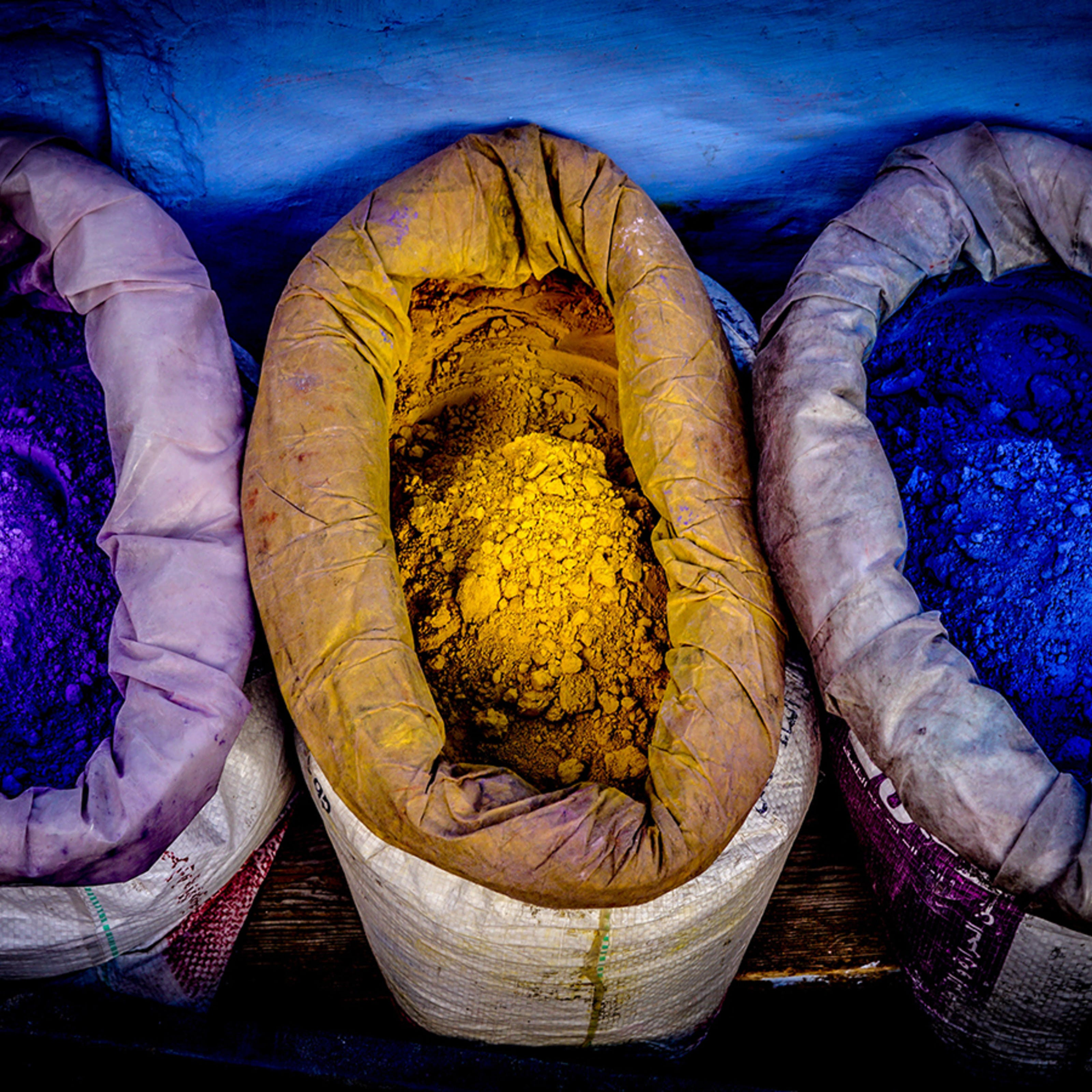 Sacks containing brightly coloured yellow and blue powder pigments
