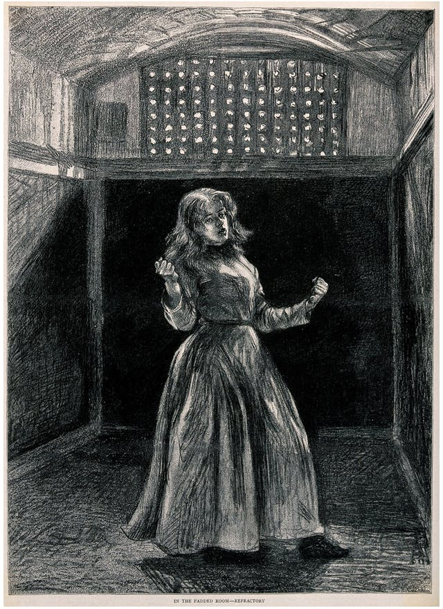 Woking Convict Invalid Prison: a woman prisoner in solitary confinement. Process print after P. Renouard, 1889.