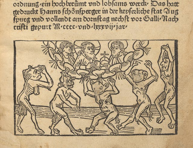 Photograph of a page from an early printed book where a previous owner has tried to rub out the faces of some of the demons.