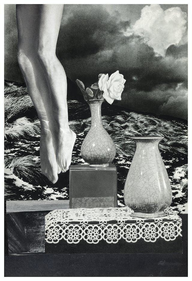 Photographic collage using images cut out from magazines and books. The scene depicts a pair of naked legs from the thigh down to the toes appearing from the top left hand corner. Next to the legs are 2 vases resting on a square plinth and a crocheted table cloth. One vase has a white rose in it, the other is empty. The background of the scene is a wind swept sand dune landscape against a heavy cloudy skyline. The overall tones of the collage are monotone, blacks, whites and greys.