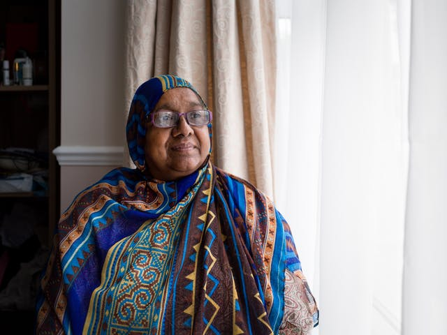 Photographic portrait of Sarifa Patel sitting next to the window in her living room.