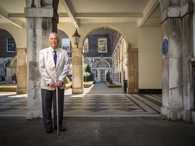 Photographic full length portrait of Leslie Cheeseman, a retired dentist, at Guy