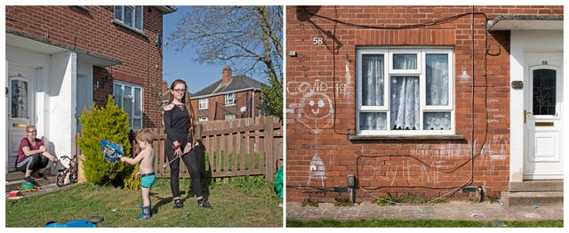 A photographic diptych. The image on the left shows a front garden and a red brick house with white PVC door and windows. It is a bright sunny day. Sitting on the steps of the front door is a young woman. Facing her is a young boy wearing shorts and wellies holding a collapsed umbrella. To the right of the boy a teenage girl dressed in black facing the camera and holding what appears to be a marching band baton.   The image on the right shows a section of the ground floor of a red brick house with a white PVC door and window with net curtains. On the brick wall surrounding the window there is a large chalk drawing of a stick person with Covid-19 written above it. Beneath the window is written 'stay home'.