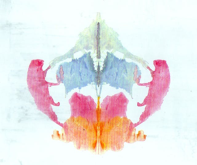 An orange pink and blue symmetrical inkblot.
