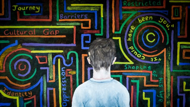Oil painting showing the back of the head and shoulders of a young boy who has a cochlear implant above his left ear. In front of him, against a black background, is a maze of coloured lines, both straight , curved and circular. In-between the lines are words and phases, for example, journey, barriers, cultural gap, restricted, it could have been you.