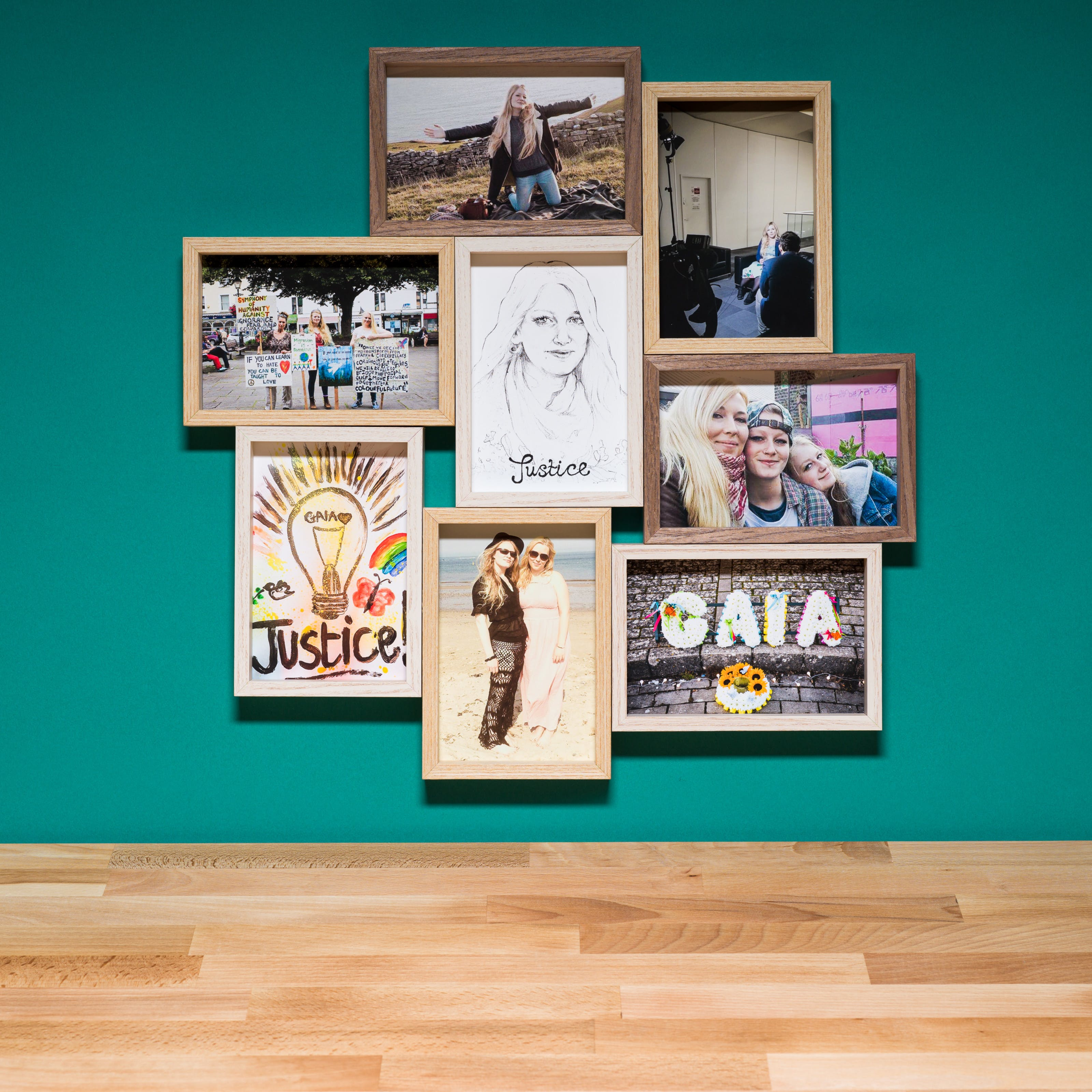 Photograph of a multiframe photo frame containing eight photographs, seven in colour and one in black and white. The frame is hung on a cyan-coloured wall above a wood block tabletop.