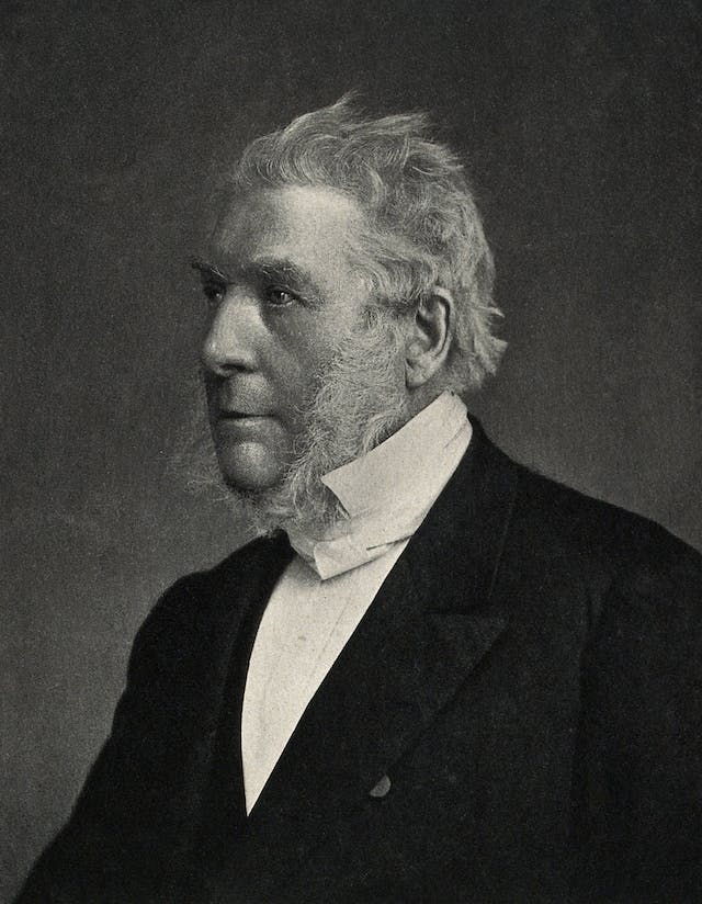 Photogravure of James Glaisher who sits looking into the distance.