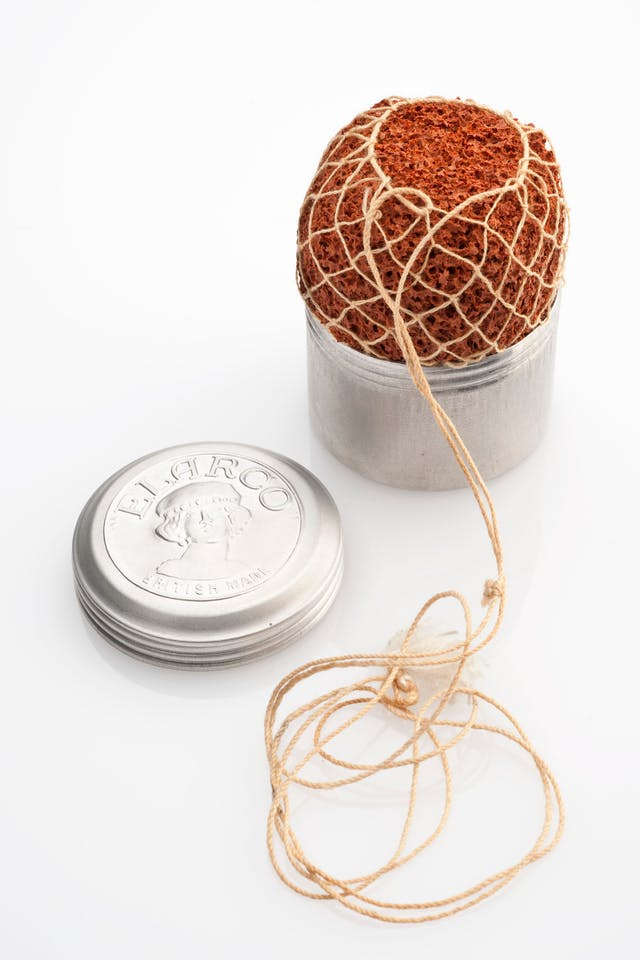Photograph of a contraceptive sponge, United Kingdom, 1901-1930.  Rubber sponge, aluminium box, twine netting.