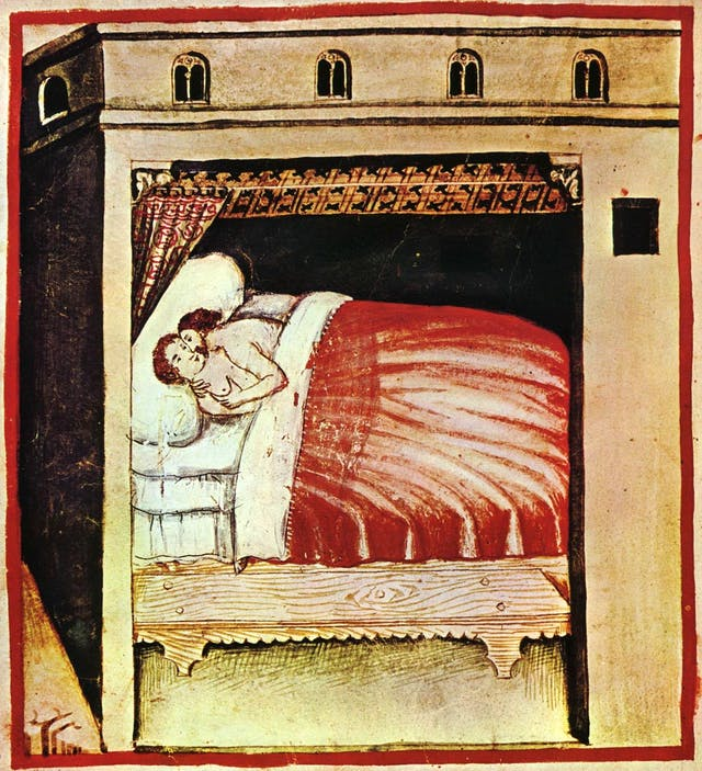 An illustration of a couple embracing in a large wooden bed, half-covered by a red bedspread.
