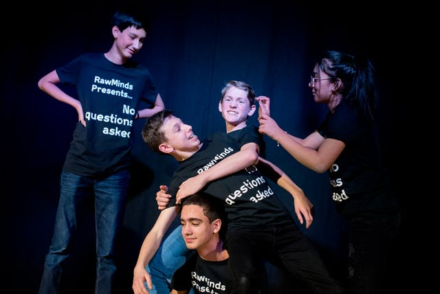 Photograph of a group of young people taking part in an improv comedy performance as part of the Wellcome Collection Raw Minds programme.