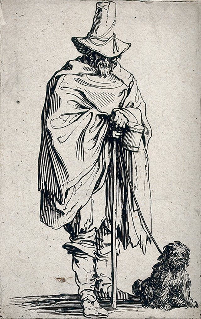 A 16th century blind man wearing a tall had and cape stands holding a stick and a collecting box with his small dog on a lead sat next to him