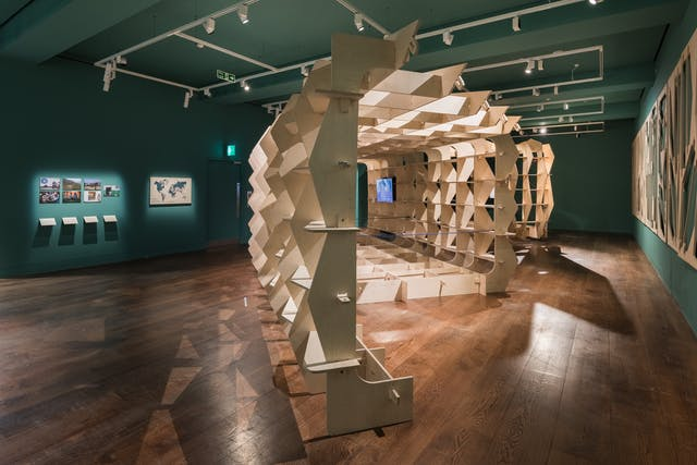 Photograph of the Global Clinic prototype, a wooden structure built in the gallery space at Wellcome Collection.