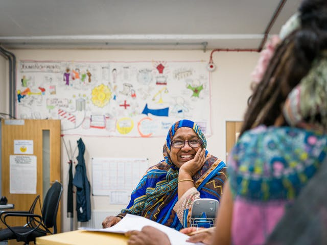 Photograph of Sarifa Patel talking with another Trustee of the charity, ALLFIE.