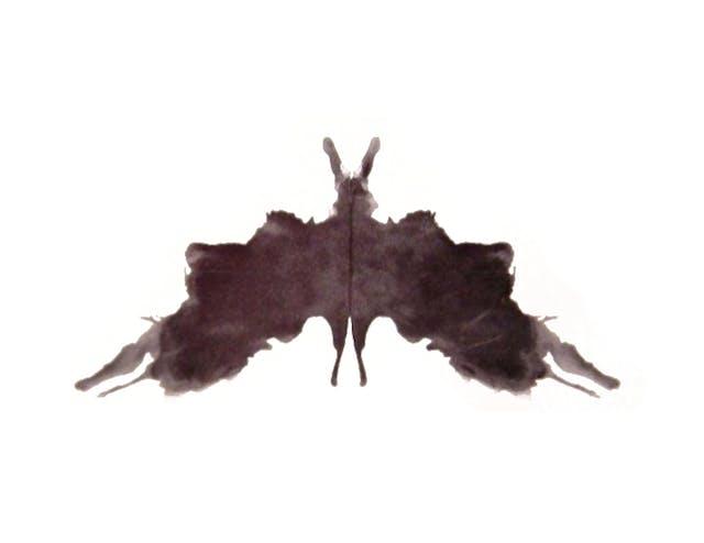 A black symmetrical inkblot.