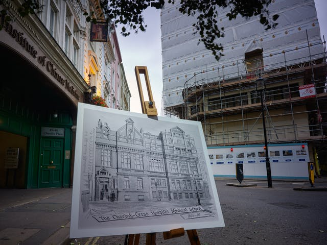 Photograph of the former Charing Cross Hospital with an historical image of the hospital displayed in front of it on a wooden artist