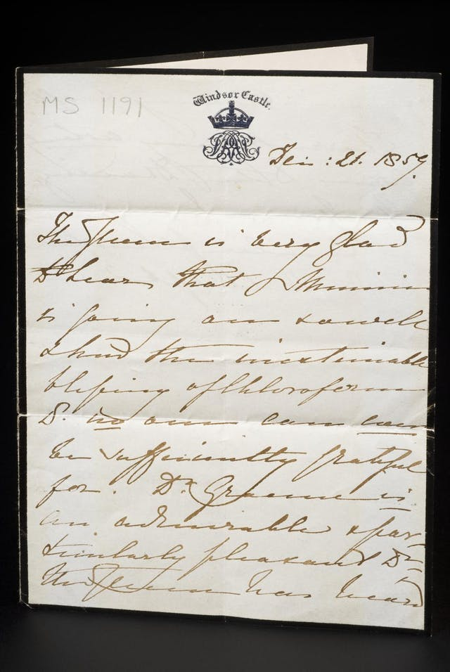 Photograph of a handwritten letter on headed notepaper, featuring the crest of Windsor Castle
