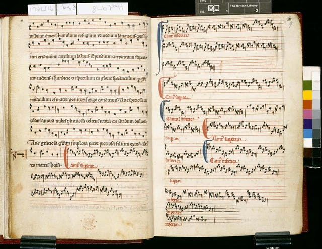 Musical notation on stave with stave-high coloured capitals.