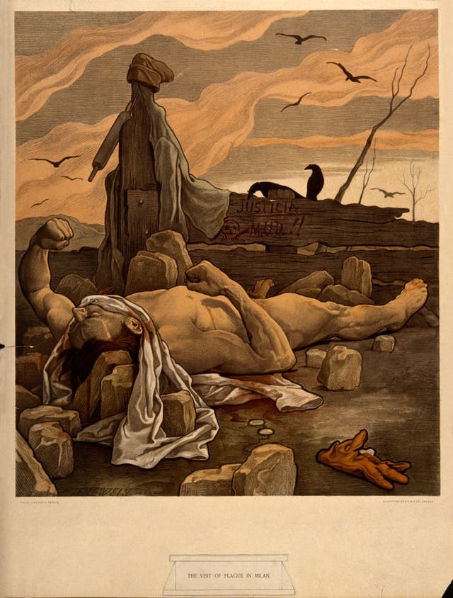 The image shows a man lying dead on some rocks. Crows fly overhead. The man