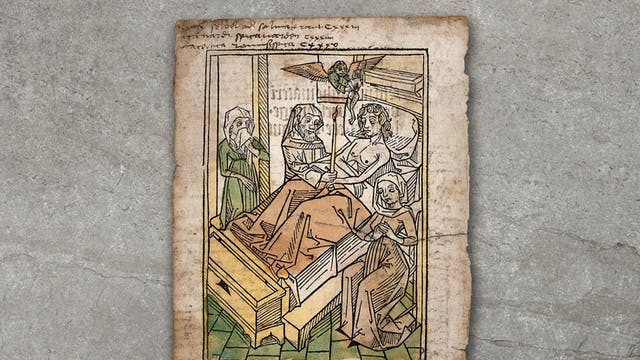 Photograph of a woodcut image, showing a man lying in bed surrounded by a priest and two women. The print is resting on a grey textured concrete background, raised slightly off the surface.