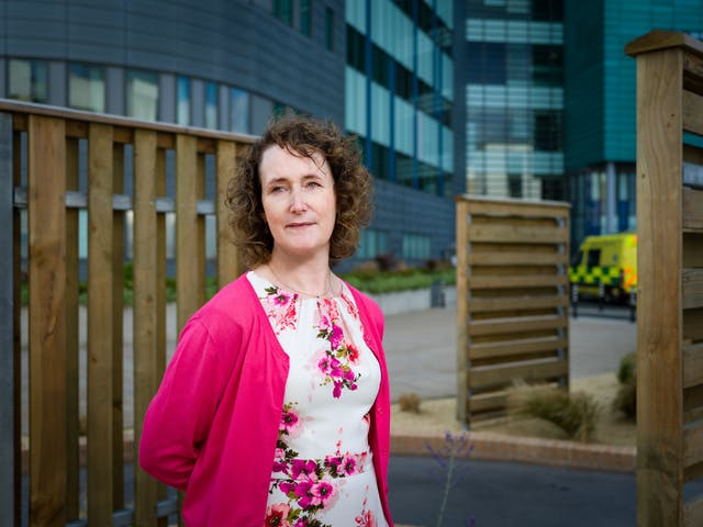 Photographic portrait of Heather Smith, consultant pharmacist, outside St James