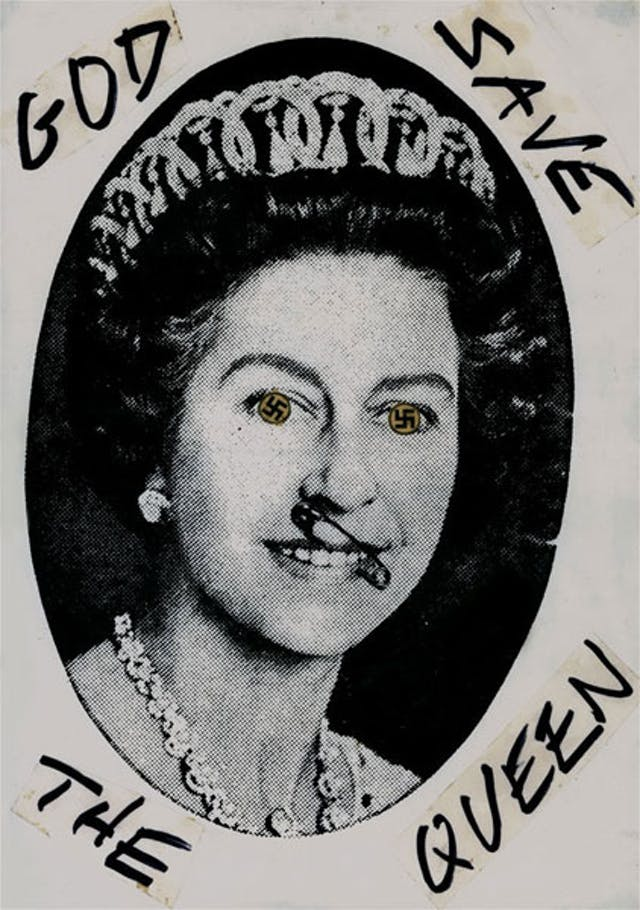 Queen Elizabeth II appears with swastikas for eyes and with a safety pin through her nose.