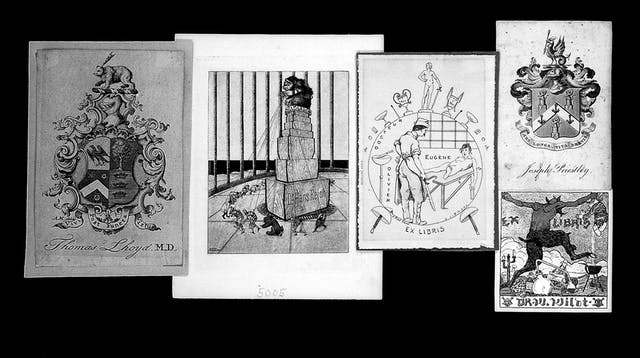 A selection of English, French, and German bookplates.  The pictures on the bookplates include coats of arms, surgery being performed, and a devil trampling on chemistry equipment.