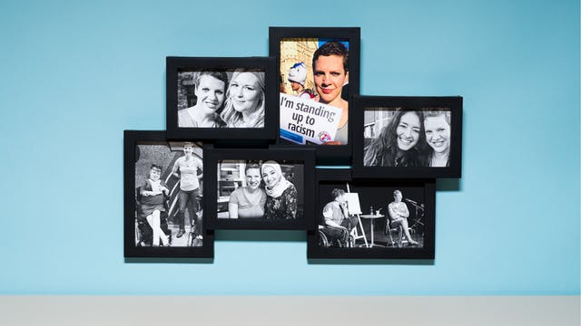 Photograph of a multi-frame photo frame containing six photographs, one in colour and the others in black and white. The frame is hung on a light blue wall above a grey tabletop.