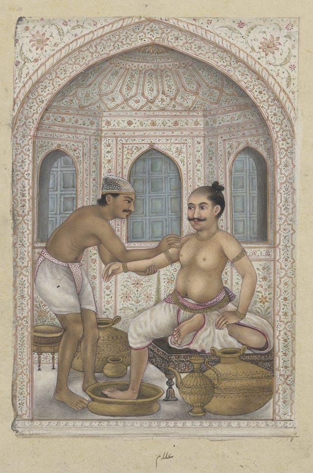 A painting showing two men, one standing, one seated, both bare chested. The standing man is massaging the seated man
