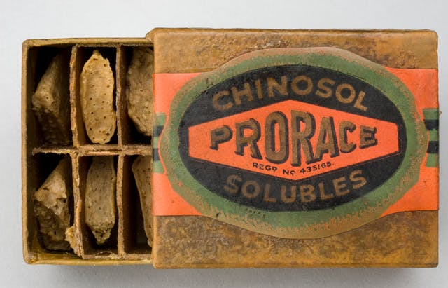 "Photograph of Spermicidal Pessaries, 'Prorace' brand, London, England, 1920s. Sleeve box with dividers holding individual pessaries. Label reads ""Prorace: Chinosol Solubles""."